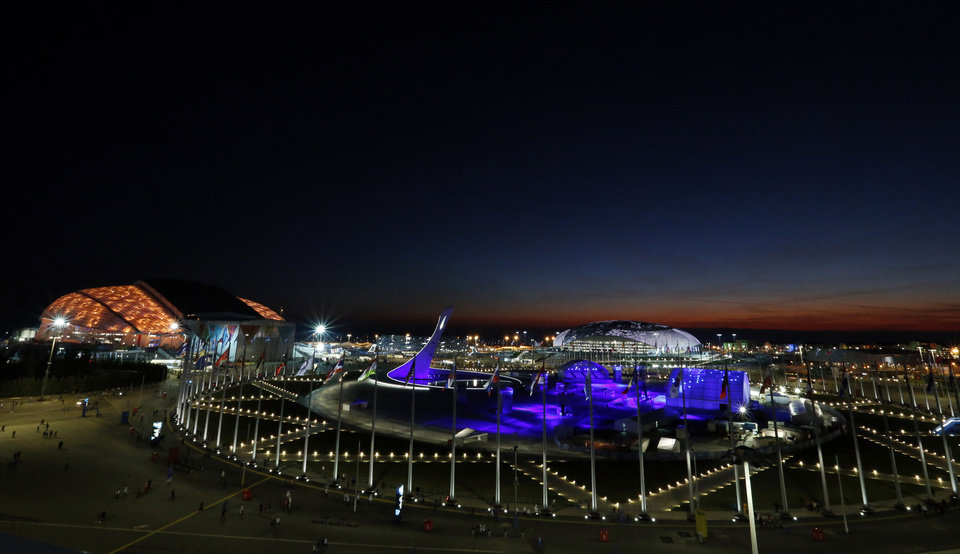 Photo - The sun sets over the Olympic Park before the opening ceremony of the 2014 Winter Olympics in Sochi, Russia, Friday, Feb. 7, 2014. (AP Photo/Julio Cortez)
