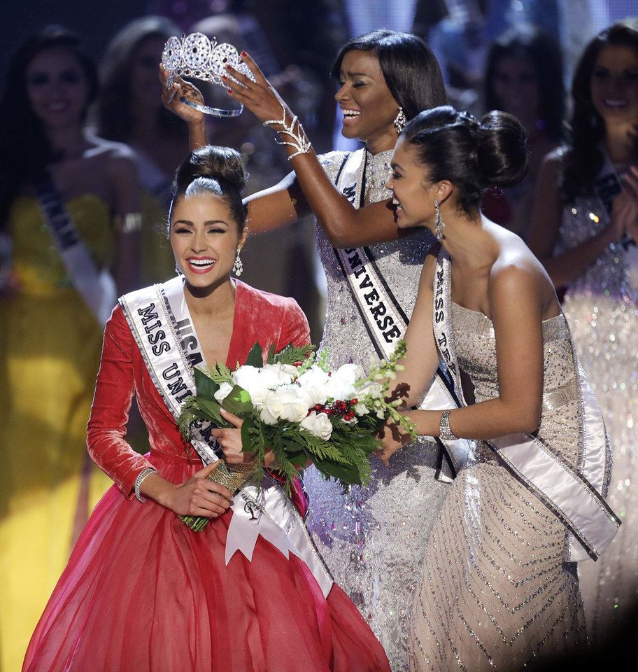 Photo - Miss USA, Olivia Culpo, left, is crowned Miss Universe during the Miss Universe competition, Wednesday, Dec. 19, 2012, in Las Vegas. (AP Photo/Julie Jacobson)