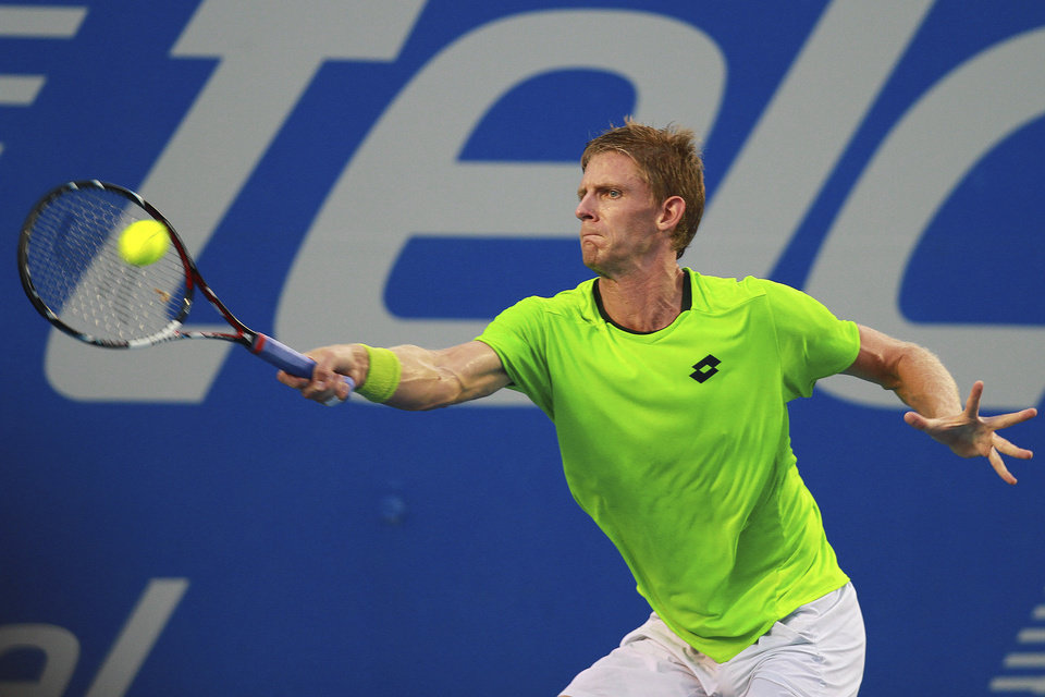 Photo - South Africa's Kevin Anderson returns the ball to Spain's David Ferrer at the Mexican Tennis Open in Acapulco, Mexico, Thursday Feb. 27, 2014. (AP Photo/Hugo Avila, JAM MEDIA)