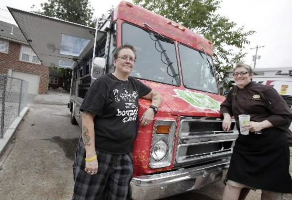 Kathryn Mathis and Cally Johnson with one of the food vending  trucks for  Big  Truck  Tacos  in Oklahoma City Tuesday Sept. 7, 2010. Photo by Paul B. Southerland, The Oklahoman