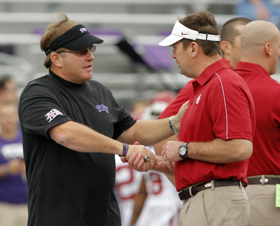 Photo - TCU head coach Gary Patterson and OU head coach Bob Stoops shake hands before the college football game between the University of Oklahoma Sooners (OU) and the Texas Christian University Horned Frogs (TCU) at Amon G. Carter Stadium in Fort Worth, Texas, on Saturday, Dec. 1, 2012. Photo by Steve Sisney, The Oklahoman