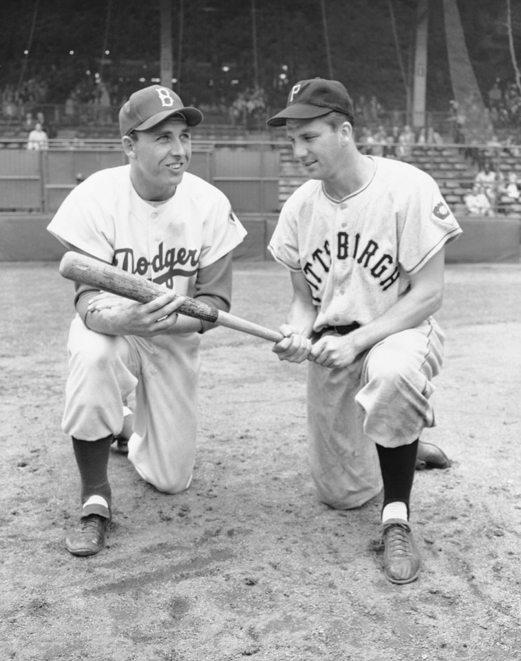 Photo - FILE - In this July 23, 1951 file photo, Gil Hodges, left, and Ralph Kiner pose. The baseball Hall of Fame says slugger Ralph Kiner has died. He was 91. The Hall says Kiner died Thursday, Feb. 6, 2014, at his home in Rancho Mirage, Calif. (AP Photo/File)