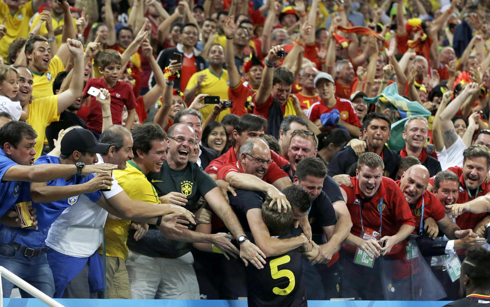 Photo - Belgium's Jan Vertonghen is swarmed by supporters after scoring his side's first goal during the group H World Cup soccer match between South Korea and Belgium at the Itaquerao Stadium in Sao Paulo, Brazil, Thursday, June 26, 2014. (AP Photo/Thanassis Stavrakis)