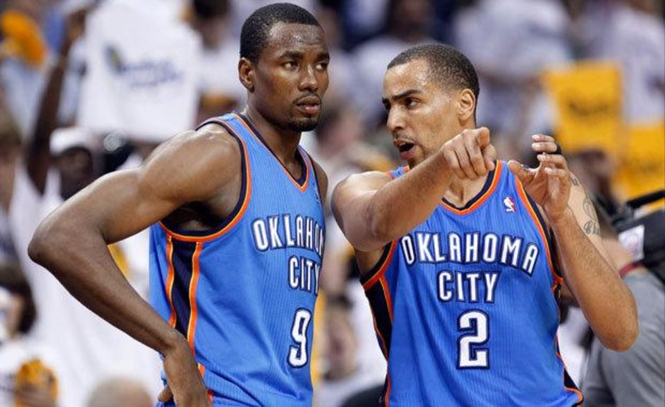 Oklahoma City Thunder guard Thabo Sefolosha (2), of Switzerland, talks with Serge Ibaka (9) during the second half of Game 6 against the Memphis Grizzlies in a second-round NBA basketball playoff series on Friday, May 13, 2011, in Memphis, Tenn. The Grizzlies won 95-83 to even the series 3-3. (AP Photo/Lance Murphey)
