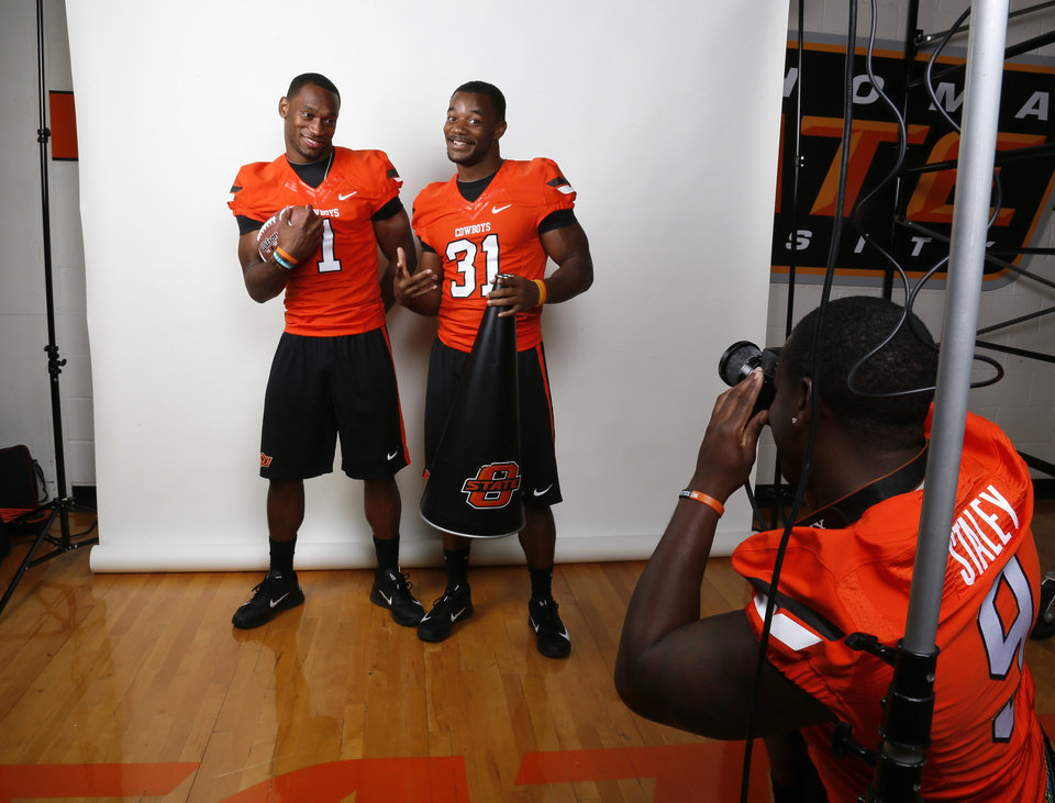 Photo - OSU's Kye Staley, right, takes a picture of Joseph Randle, left, and Jeremy Smith as they joke around during a photo shoot at media day for the OSU football team at Gallagher-Iba Arena in Stillwater, Okla., Saturday, Aug. 4, 2012. Photo by Nate Billings, The Oklahoman
