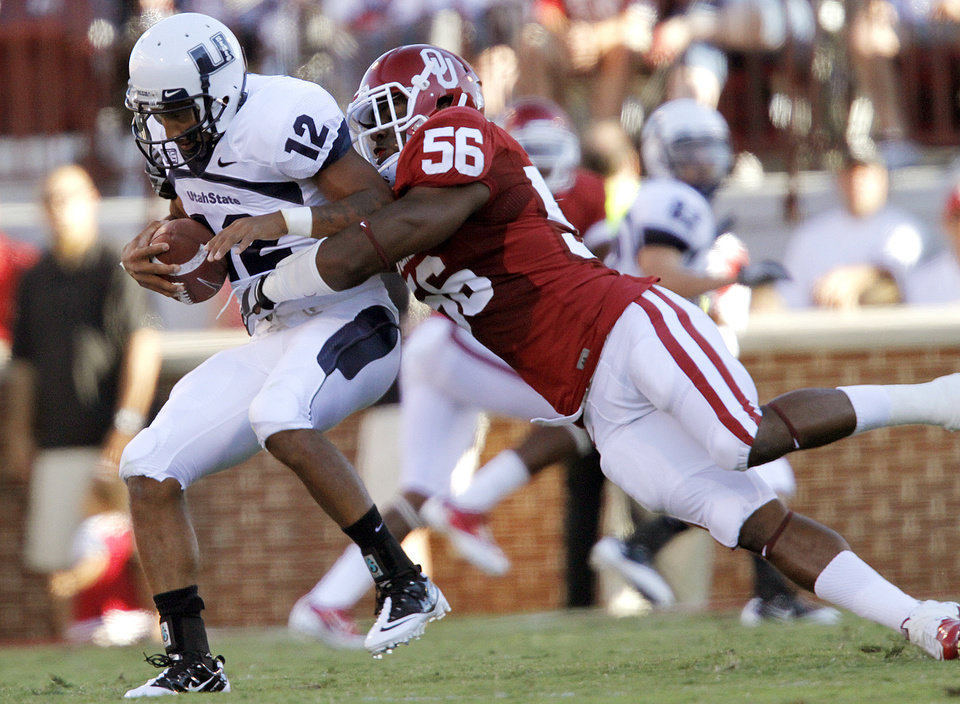 Photo - Oklahoma's Ronnell Lewis (56) sacks Utah State quarterback Diondre Borel (12) during the first half of the college football game between the University of Oklahoma Sooners (OU) and Utah State University Aggies (USU) at the Gaylord Family-Oklahoma Memorial Stadium on Saturday, Sept. 4, 2010, in Norman, Okla.   Photo by Chris Landsberger, The Oklahoman