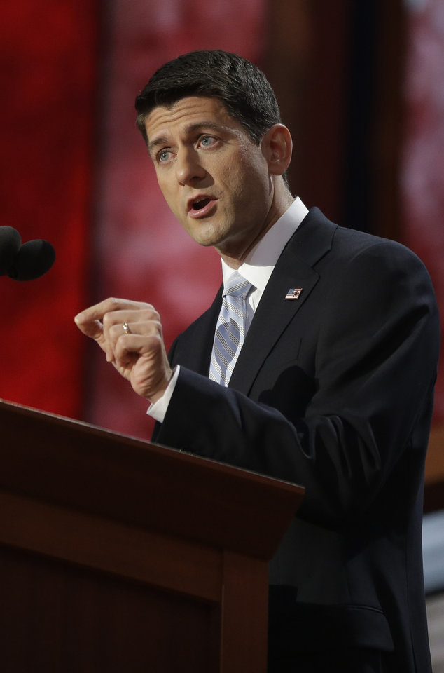 Photo -   Republican vice presidential nominee, Rep. Paul Ryan addresses the Republican National Convention in Tampa, Fla., on Wednesday, Aug. 29, 2012. (AP Photo/Charles Dharapak)