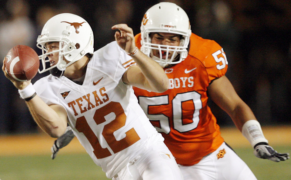 Photo - Texas quarterback Colt McCoy (12) scrambles away from OSU's Jamie Blatnick (50) during the college football game between the Oklahoma State University Cowboys (OSU) and the University of Texas Longhorns (UT) at Boone Pickens Stadium in Stillwater, Okla., Saturday, Oct. 31, 2009. Photo by Nate Billings, The Oklahoman