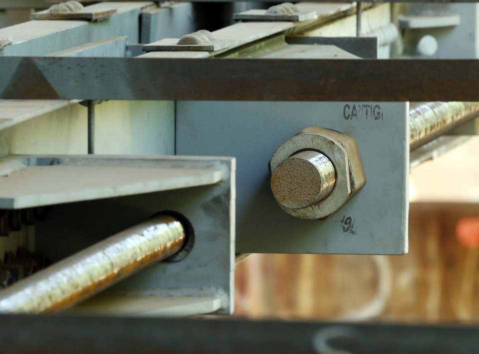 Photo -  Repair brackets and bolts have been installed under the James C. Nance Bridge between Lexington and Purcell. PHOTO BY STEVE SISNEY, THE OKLAHOMAN   STEVE SISNEY -