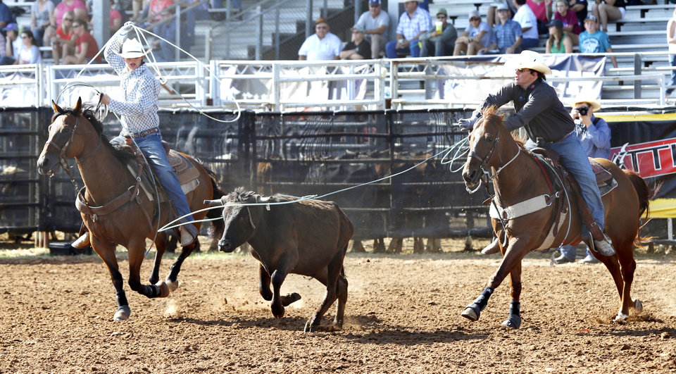 Sterlin Shoemaker and Denton Halford, both from Texas, compete in team roping on day 4 of the International Finals Youth Rodeo on Wednesday, July 10, 2013 in Shawnee, Okla.  Photo by Steve Sisney, The Oklahoman