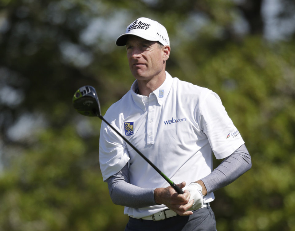 Jim Furyk, of Ponte Vedra Beach, Fla., watches his drive on the second tee during the second round of the Texas Open golf tournament, Friday, April 5, 2013, in San Antonio.  (AP Photo/Eric Gay)
