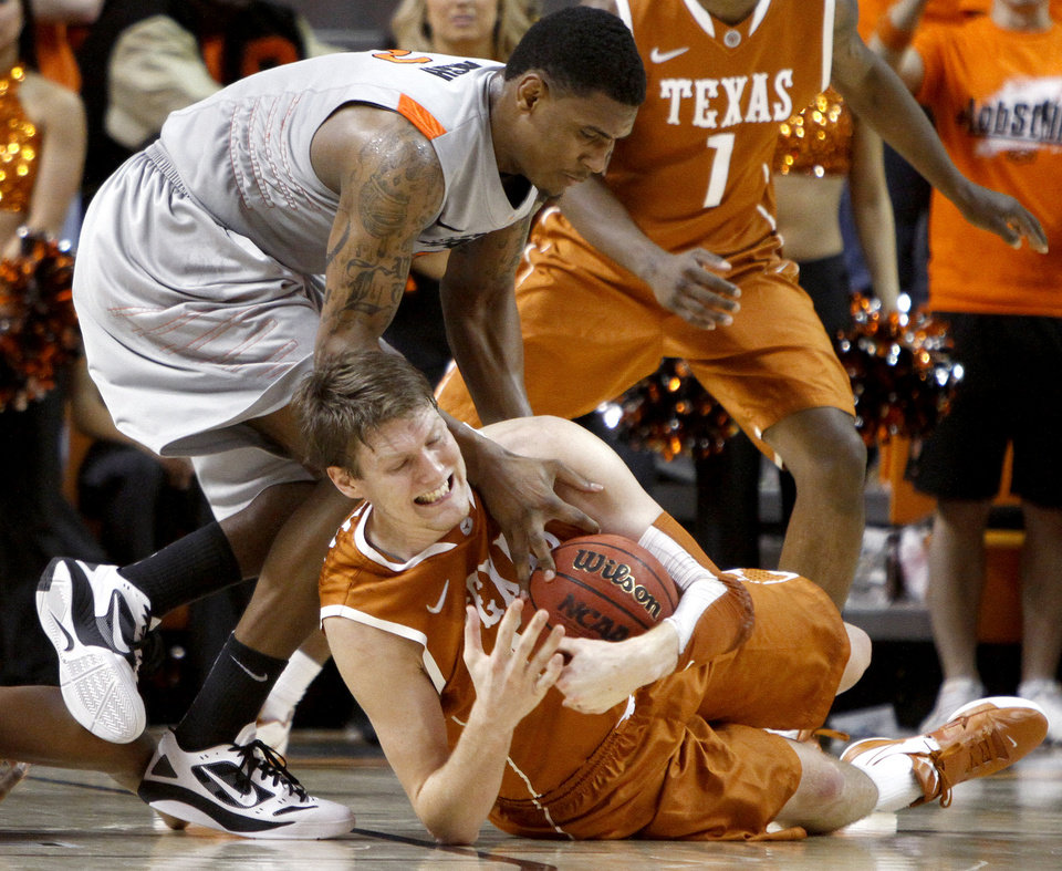 Oklahoma State's Le'Bryan Nash , left, and Texas' Clint Chapman go for a loose ball during an NCAA college basketball game between Oklahoma State University (OSU) and the University of Texas (UT) at Gallagher-Iba Arena in Stillwater, Okla., Saturday, Feb. 18, 2012. Oklahoma State won 90-78. Photo by Bryan Terry, The Oklahoman