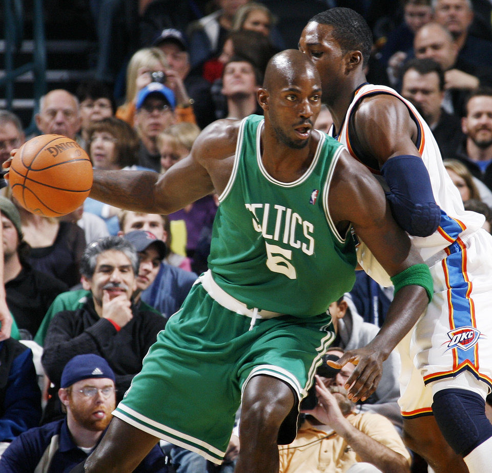 Photo - Kevin Garnett (5) of the Celtics moves around Oklahoma City's Jeff Green (22) in the first half of the NBA basketball game between the Boston Celtics and the Oklahoma City Thunder at the Ford Center in Oklahoma City, Friday, Dec. 4, 2009. Photo by Nate Billings, The Oklahoman ORG XMIT: KOD