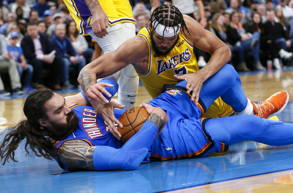 Photo - Oklahoma City's Steven Adams (12) and Los Angeles' JaVale McGee (7) battle for possession of the ball before a jump ball is called in the second quarter during an NBA basketball game between the Oklahoma City Thunder and the Los Angeles Lakers at Chesapeake Energy Arena in Oklahoma City, Friday, Nov. 22, 2019. [Nate Billings/The Oklahoman]
