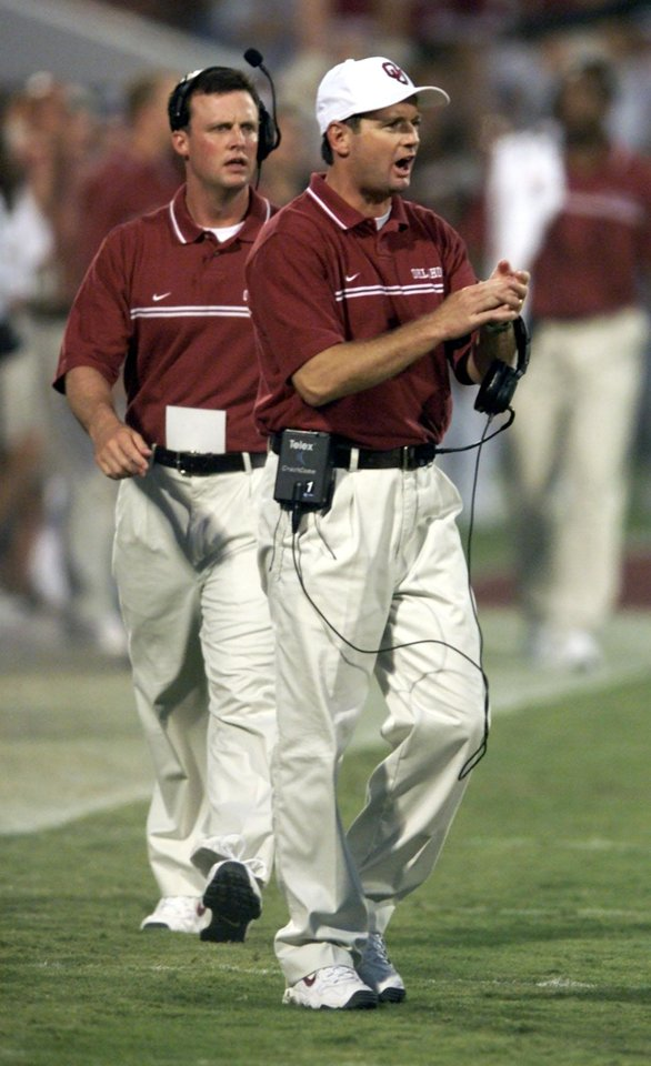 Photo - University of North Carolina (UNC) vs OU college football in Norman, OK Saturday Aug 25, 2001.  Head coach Bob Stoops cheers his team.  Staff photo by Steve Sisney