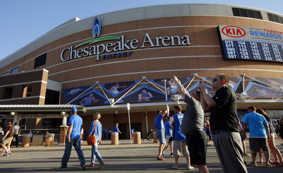 Photo - Fans walk outside the arena before Game 1 of the Western Conference semifinals in the NBA playoffs between the Oklahoma City Thunder and the Los Angeles Clippers at Chesapeake Energy Arena in Oklahoma City, Monday, May 5, 2014. Photo by Bryan Terry, The Oklahoman