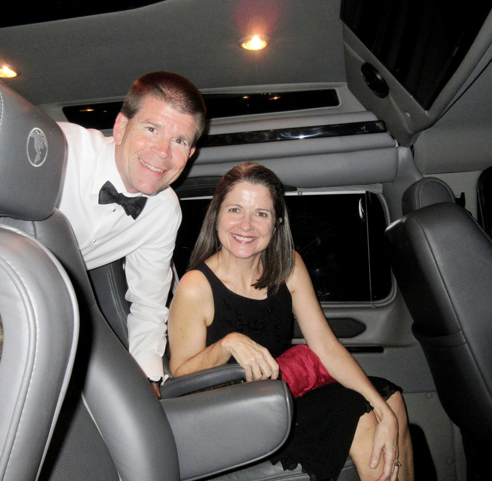 Photo - John and Darla deSteiguer traveling by van from Oklahoma City to Tulsa. PHOTO BY HELEN FORD WALLACE, THE OKLAHOMAN