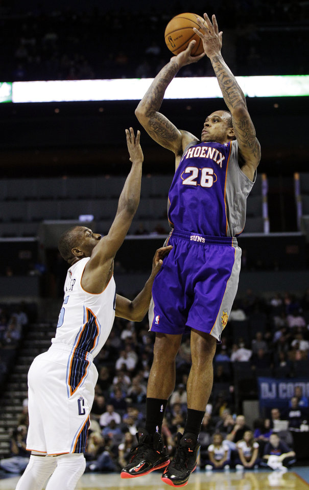 Photo -   Phoenix Suns' Shannon Brown (26) shoots over Charlotte Bobcats' Kemba Walker (15) during the second half of an NBA basketball game in Charlotte, N.C., Wednesday, Nov. 7, 2012. Phoenix won 117-110. (AP Photo/Chuck Burton)