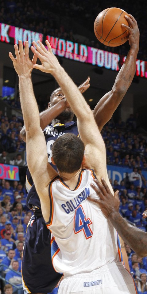 Photo - Memphis' Tony Allen (9) drives the ball against Oklahoma City's Nick Collison (4) during game one of the Western Conference semifinals between the Memphis Grizzlies and the Oklahoma City Thunder in the NBA basketball playoffs at Oklahoma City Arena in Oklahoma City, Sunday, May 1, 2011. Photo by Chris Landsberger, The Oklahoman