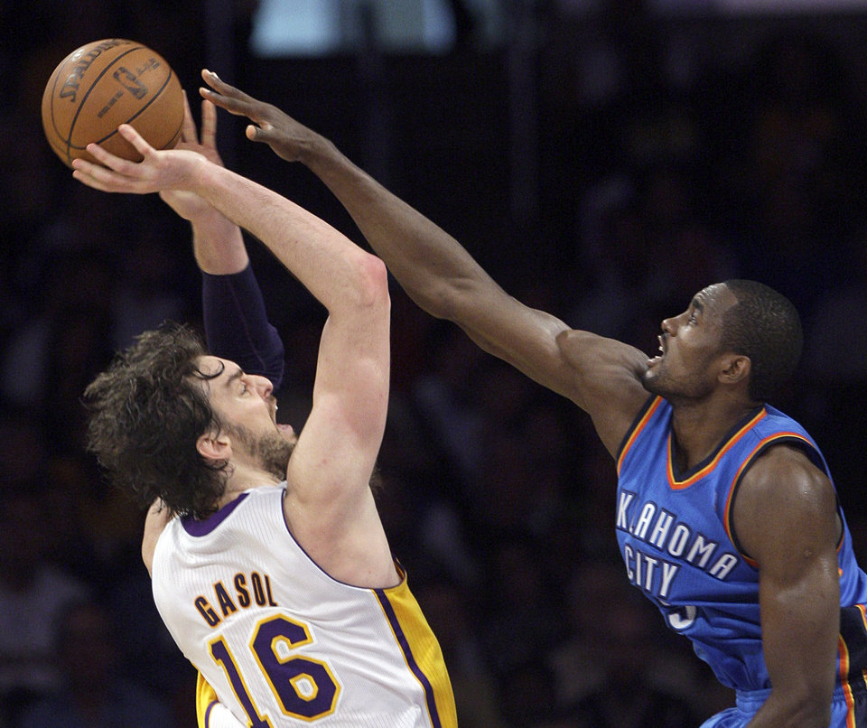 Los Angeles Lakers forward Paul Gasol, of Spain, shoots against Oklahoma City Thunder defender Serge Ibaka in the second half of an NBA basketball game in Los Angeles, Sunday, April 22, 2012. The Lakers won 114-106 in double overtime. Gasol had 20 points, 14 rebounds and nine assists for the win. (AP Photo/Reed Saxon) ORG XMIT: LAS113