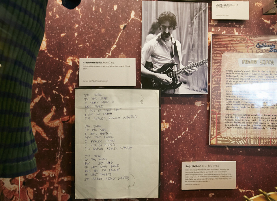 Photo - In this Friday, May 9, 2014 photo, musician Frank Zappa's handwritten lyrics and photo are displayed at the Grammy Museum exhibit