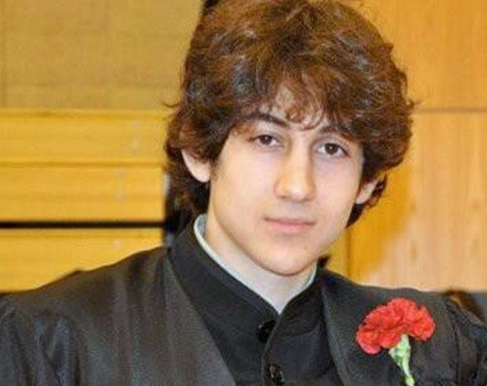 Photo - In this undated photo provided by Robin Young, Dzhokhar A. Tsarnaev, poses for a photo after graduating from Cambridge Rindge and Latin High School. Tsarnaev has been identified as the surviving suspect in the marathon bombings. Two suspects in the Boston Marathon bombing killed an MIT police officer, injured a transit officer in a firefight and threw explosive devices at police during a getaway attempt in a long night of violence that left one of them dead and another still at large Friday, April 19, 2013. (AP Photo/Robin Young)