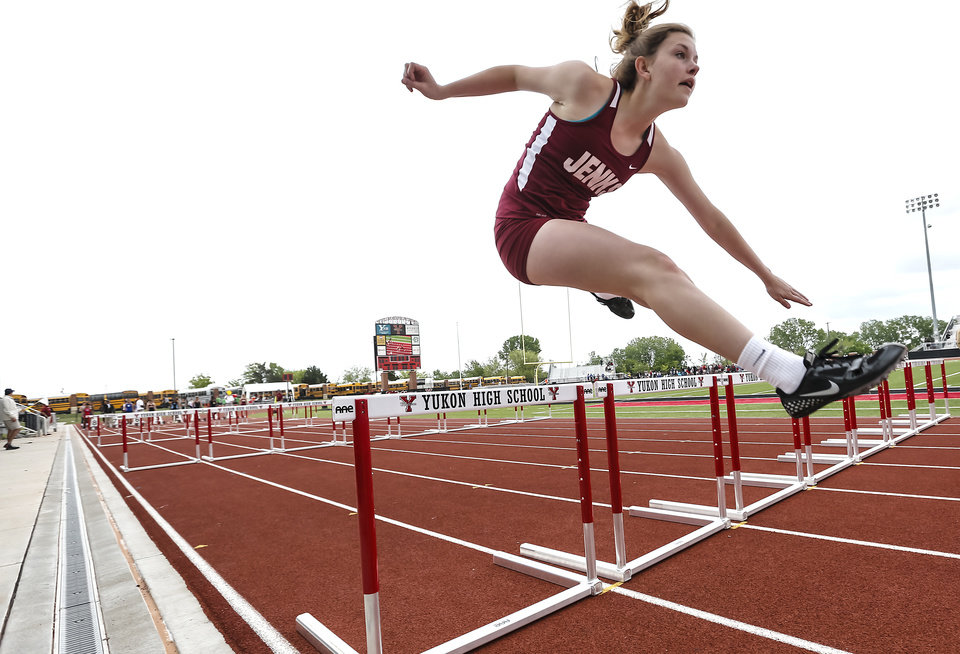 Photo - Jenks' Natalie Mckillip clears the hurdle in the 6A girls 100m hurdle during the class 5A and 6A track state championships at Yukon High School on on Friday, May 10, 2013, in Yukon, Okla.Photo by Chris Landsberger, The Oklahoman