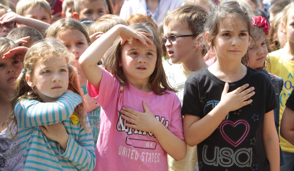 Cayman Casey, Isabella Tarantelli and Charlie Ziegler salute during the pledge of allegiance during a Veteran\'s School Flag Program presentation at Prairie Vale Elementary School, Thursday, March 15, 2012. Photo By David McDaniel/The Oklahomen