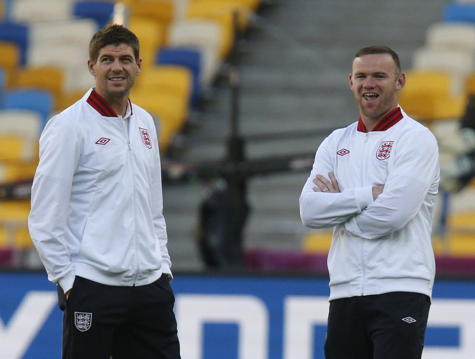 England's Wayne Rooney, right and Steven Gerrard smile during a visit to the Olympiyskiy stadium prior to the Euro 2012 soccer quarterfinal match between England and Italy in Kiev, Ukraine, Saturday, June 23, 2012. (AP Photo/Efrem Lukatsky)