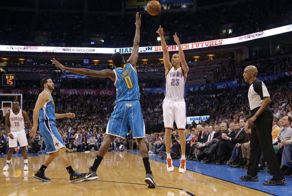 Oklahoma City Thunder\'s Kevin Martin (23) shoots over New Orleans Hornets\' Al-Farouq Aminu (0) during the NBA basketball game between the Oklahoma City Thunder and the New Orleans Hornets at the Chesapeake Energy Arena on Wednesday, Feb. 27, 2013, in Oklahoma City, Okla. Photo by Chris Landsberger, The Oklahoman