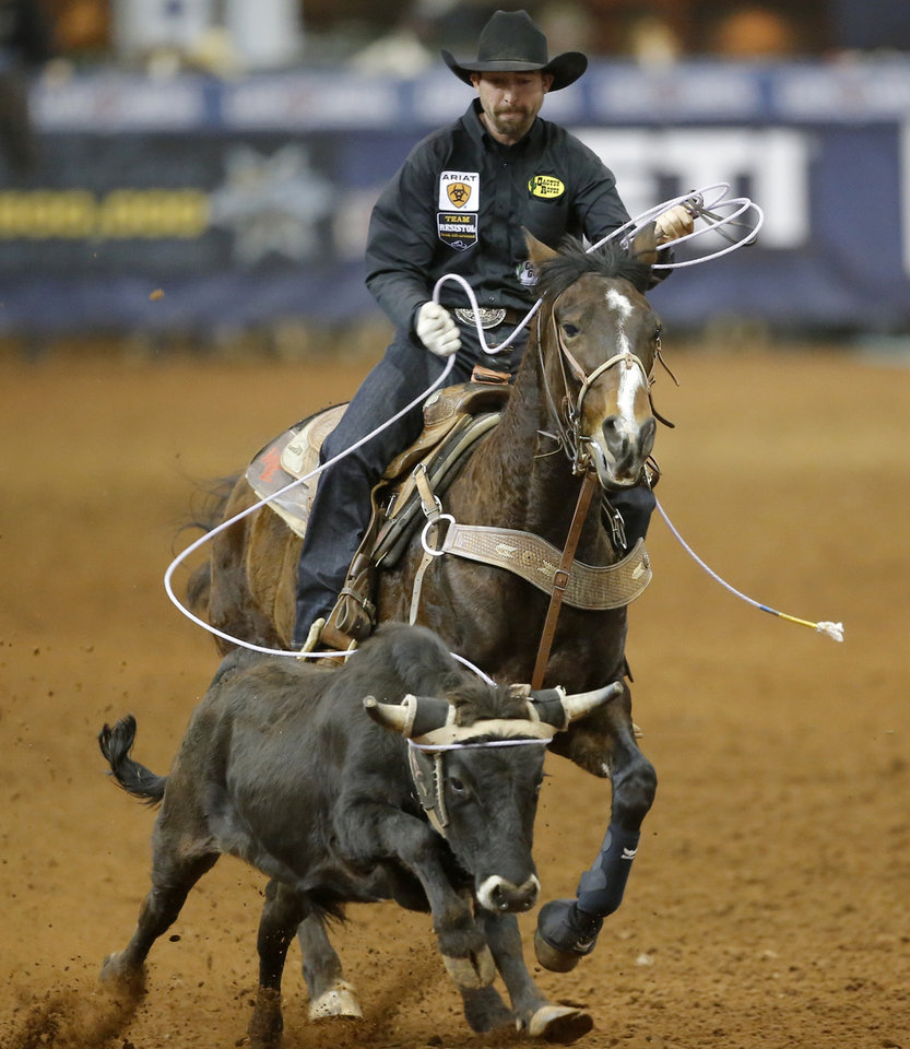 Photo - Lane S Karney of Creston, California, competes in the heading event during the Timed Event Championship inside the Lazy E Arena in Guthrie, Okla., Friday, March 13, 2020. [Bryan Terry/The Oklahoman]
