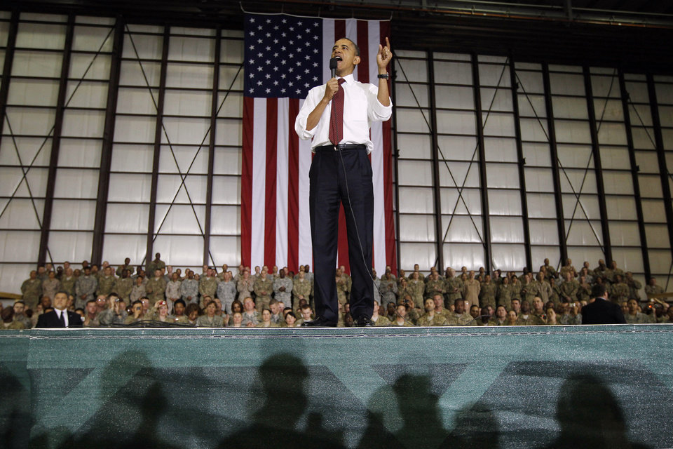 Photo - FILE - This May 2, 2012 file photo shows President Barack Obama addressing troops at Bagram Air Field, Afghanistan. President Obama has made a surprise trip to Afghanistan for a Memorial Day weekend visit with U.S. troops serving in America's longest war.(AP Photo/Charles Dharapak)