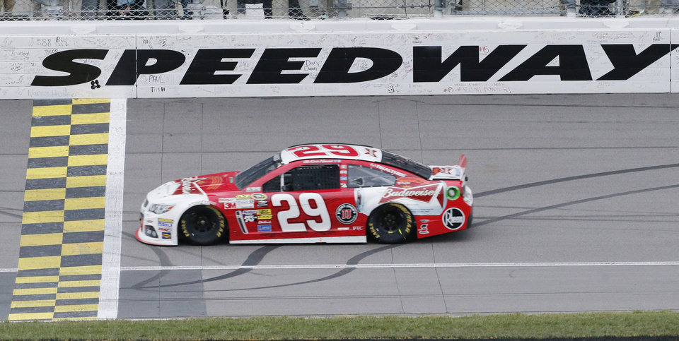 Photo - Driver Kevin Harvick (29) crosses the finish line to win the NASCAR Sprint Cup series auto race at Kansas Speedway in Kansas City, Kan., Sunday, Oct. 6, 2013.  (AP Photo/Orlin Wagner)