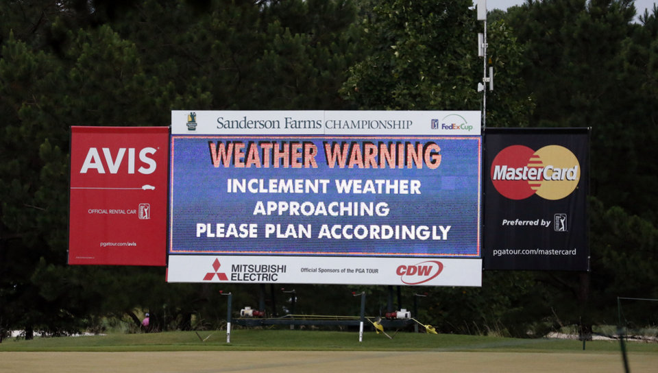 Photo - Course officials posted this weather warning as the clouds darkened during the first round of the Sanderson Farms Championship golf tournament, Thursday, July 18, 2013 in Madison, Miss. (AP Photo/Rogelio V. Solis)