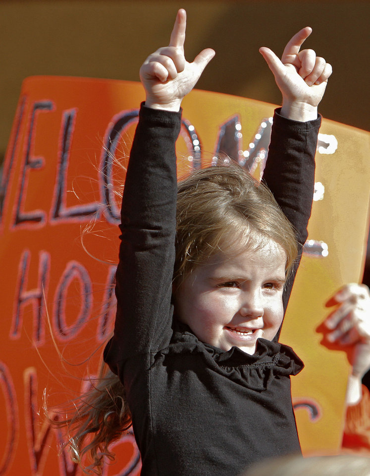 Lauren Crosthwait, 3, cheers for her Cowboys as the Oklahoma State University football team arrives at the Stillwater Airport from their BCS Fiesta Bowl win on Tuesday, Jan. 3, 2012, in Stillwater, Okla. The Cowboys defeated Stanford 41-38 in overtime. Photo by Chris Landsberger, The Oklahoman