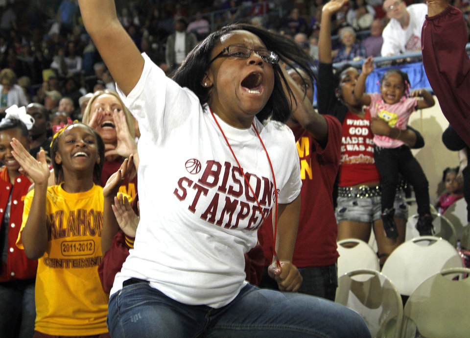 Photo - Bison fan Sharee Guin reacts after as Centennial takes the lead during the 3A boys State Basketball Championship game between Victory Christian High School and Centennial High School at State Fair Arena on Saturday, March 10, 2012 in Oklahoma City, Okla.  Photo by Chris Landsberger, The Oklahoman
