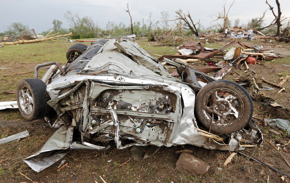 The remains of a car destroyed by a tornado that hit the area near 149th and Drexel on Monday, May 20, 2013 in Oklahoma City, Okla.  Photo by Chris Landsberger, The Oklahoman