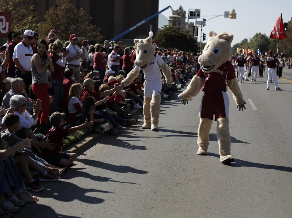 Boomer and Sooner walk down Boyd Street during the University of Oklahoma Homecoming Parade in Norman, Okla., Saturday, Oct. 20, 2012. Photo by Garett Fisbeck, The Oklahoman