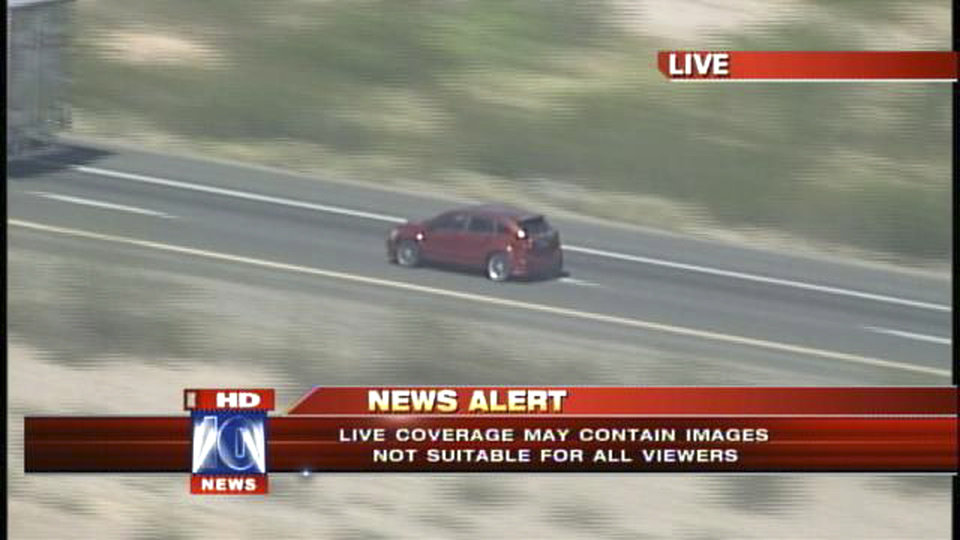 In this video grab provided by Fox 10 News, a vehicle involved in a police car chase is followed on an interstate highway by a television station helicopter west of Phoenix, Friday, Sept. 28, 2012. Police say a man fatally shot himself in the head on live national television at the end of the high-speed chase that began in Phoenix when the driver stopped, ran into the desert and placed a handgun to his head and fired. (AP Photo/Fox 10 News)