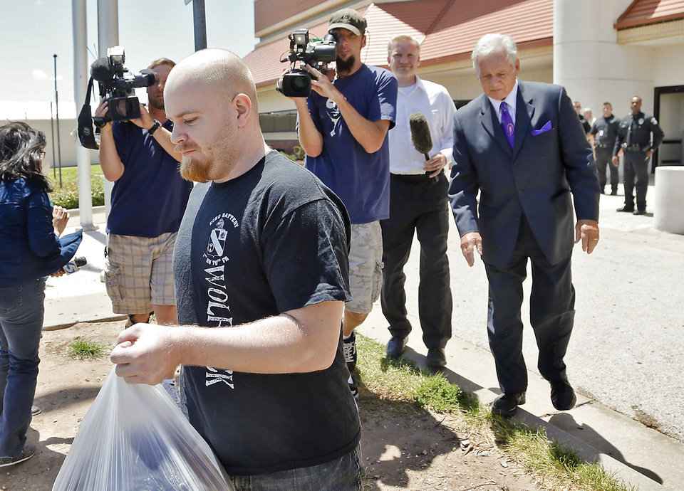 Attorney Irven Box walks with Justin Adams as he is released from the Oklahoma County Jail on $100,000 bond in Oklahoma City, Okla. on Wednesday, July 25, 2012.   Photo by Chris Landsberger, The Oklahoman
