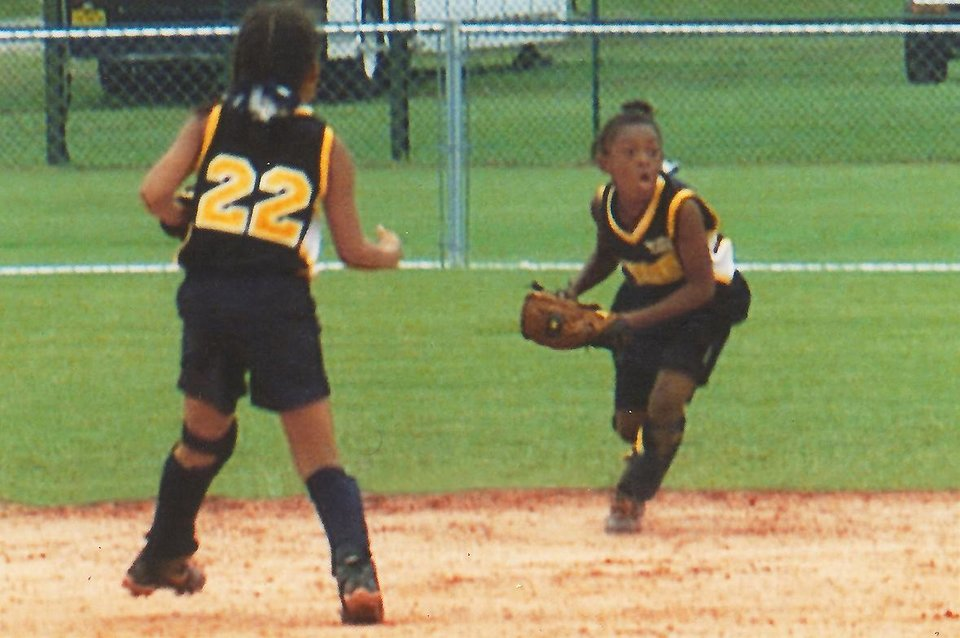 Photo - Courtney Walker makes a play on the softball field. PHOTO PROVIDED
