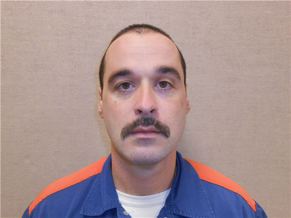 Photo - This Feb. 11, 2013 photo provided by the Michigan Department of Corrections shows Michael David Elliot. Elliot, who is serving life behind bars for murder in four 1993 deaths in Michigan, has escaped from prison and may have abducted a woman before she got away in Indiana, according to officials. Michigan Department of Corrections spokesman Russ Marlan says in an email that 40-year-old Elliot was discovered missing about 9:30 p.m. Sunday, Feb. 2, 2014, from the Ionia Correctional Facility in mid-Michigan. (AP Photo/Michigan Department of Corrections)