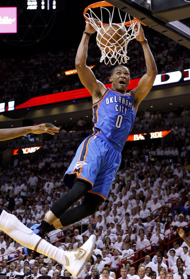 Photo - NBA BASKETBALL: Oklahoma City's Russell Westbrook (0) dunks the ball during Game 4 of the NBA Finals between the Oklahoma City Thunder and the Miami Heat at American Airlines Arena, Tuesday, June 19, 2012. Photo by Bryan Terry, The Oklahoman