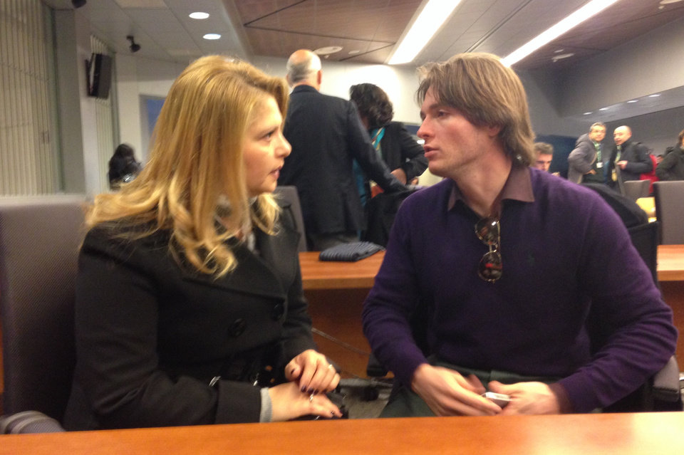 Photo - Raffaele Sollecito talks with his stepmother Mara Papagni prior to the start of the final hearing before the third court verdict for the murder of British student Meredith Kercher, in Florence, Italy, Thursday, Jan. 30, 2014. The first two trials produced flip-flop verdicts of guilty then innocent for Kercher former roommate, American student Amanda Knox, who is not attending the hearing,  and her former Italian boyfriend, Raffaele Sollecito, and the case has produced harshly clashing versions of events. A Florence appeals panel designated by Italy's supreme court to address issues it raised about the acquittal is set to deliberate Thursday, with a verdict expected later in the day. (AP Photo/Lapresse) ITALY OUT