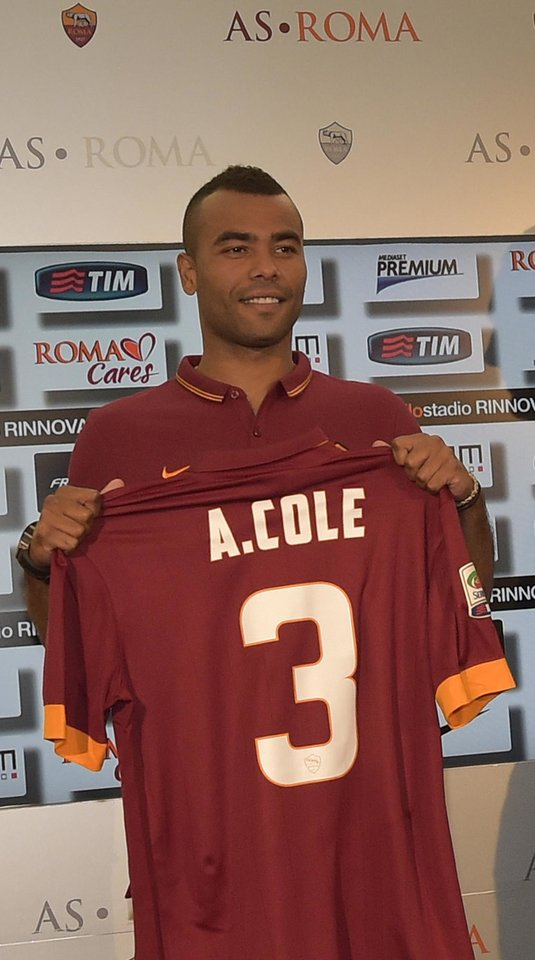 Photo - Former Chelsea left back Ashley Cole poses with his new Roma jersey during the official presentation in Rome Tuesday, July 15, 2014. Cole signed a two-year deal with Roma last week and was presented with the Giallorossi's No. 3 shirt Tuesday. The 33-year-old Cole spent the past eight seasons with Chelsea, and was with London rival Arsenal for the previous six years. (AP Photo/Alfredo Falcone, Lapresse) ITALY OUT