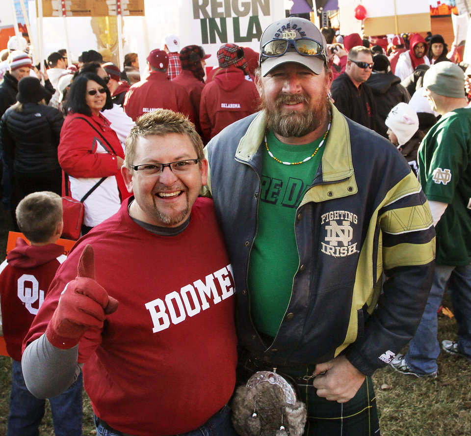 Garry Canaday, right, is a lifelong Notre Dame fan. For his birthday, his best friend, Brook Bullock,Oklahoma City, left, an avid Sooners fan, purchased tickets to Saturday\'s OU-Notre Dame football game. Canaday, who lives in Tonkawa, wore a kilt to the game. He said he is Scottish and the kilt represents his clan\'s tartan. ESPN broadcast their weekly pre-game sports show, GameDay, from the the campus of the University of Oklahoma, Saturday morning, Oct. 27, 2012. The network\'s broadcast few is in Norman for the OU - Notre Dame football game Saturday night. Several thousand OU fans and a smattering of Notre Dame supporters , many carrying homemade signs, crowded around the stage to watch the live broadcast. Photo by Jim Beckel, The Oklahoman