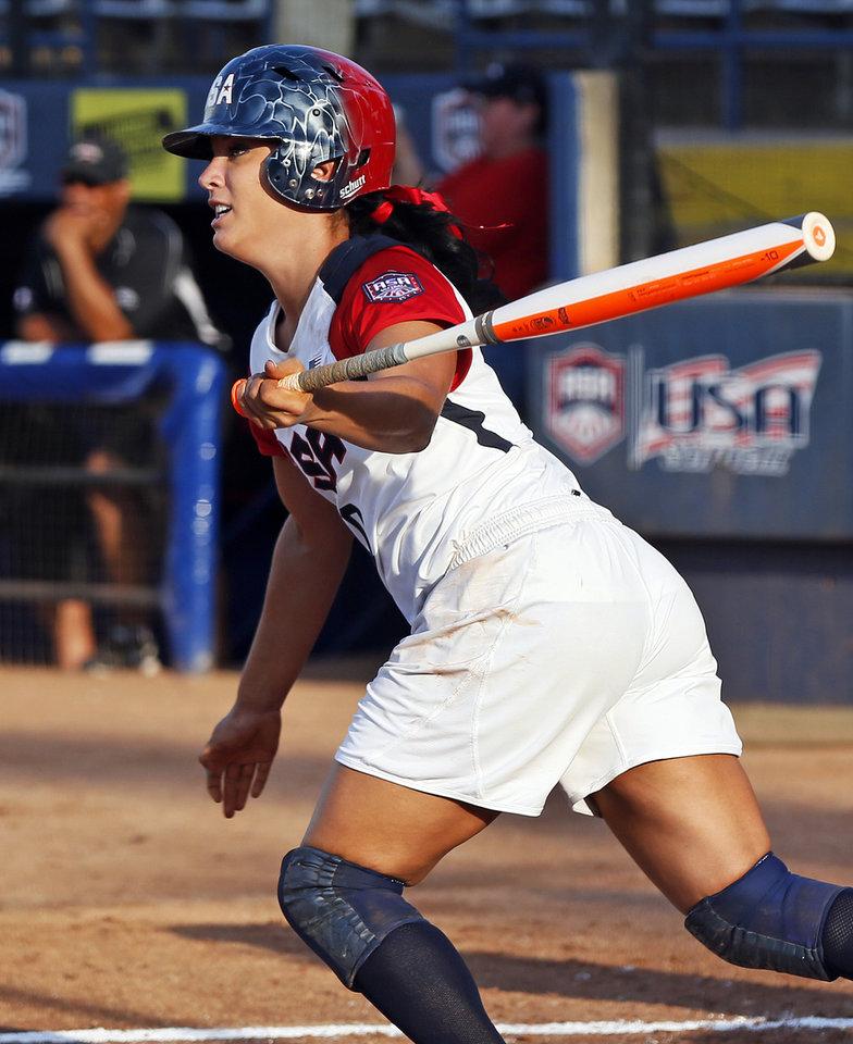 Photo - Valerie Arioto (20) of the United States drives in two runs with a single in the first inning during a game between Team USA and Canada in the World Cup of Softball at ASA Hall of Fame Stadium in Oklahoma City, Thursday, July 11, 2013. Team USA won 7-0 in 6 innings. Photo by Nate Billings, The Oklahoman