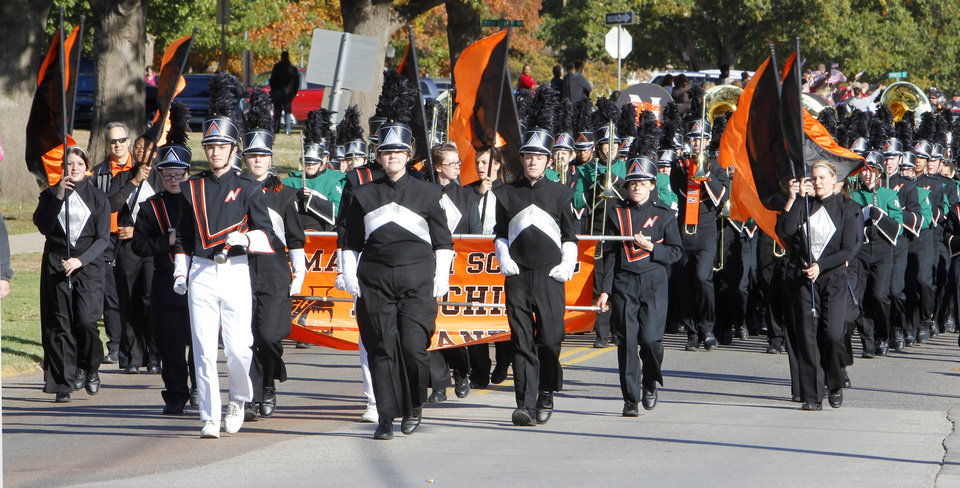 Norman High School and Norman North High School bands march together in the Veterans Day Parade in Norman Friday, Nov. 11, 2011. Photo by Paul B. Southerland, The Oklahoman