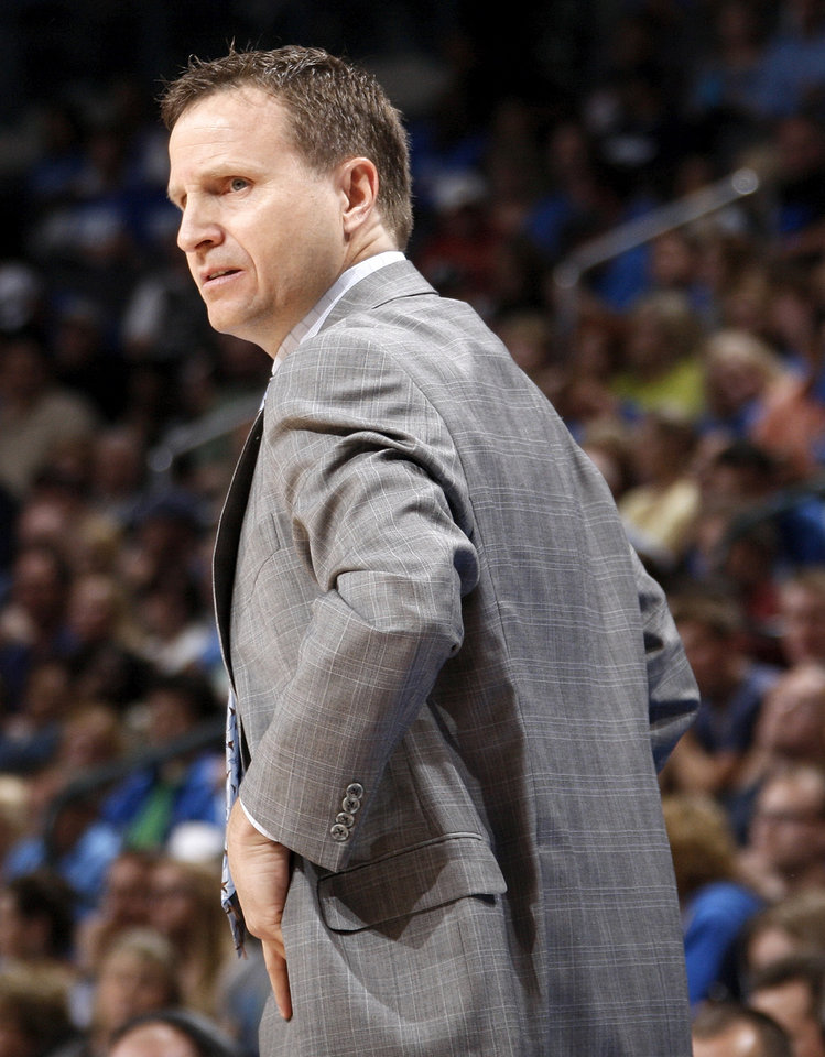 Oklahoma City head coach Scott Brooks watches his team during the NBA basketball game between the Oklahoma City Thunder and the Sacramento Kings at Chesapeake Energy Arena in Oklahoma City, Friday, April 13, 2012. Oklahoma City won, 115-89. Photo by Nate Billings, The Oklahoman