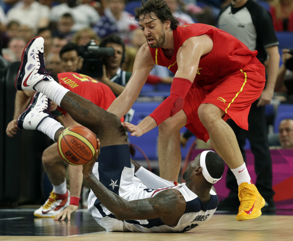 United States' LeBron James and Spain's Pau Gasol battle for a loose ball during the men's gold medal basketball game at the 2012 Summer Olympics, Sunday, Aug. 12, 2012, in London. (AP Photo/Charles Krupa)